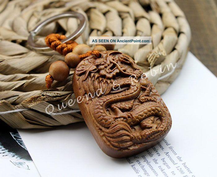 Peach Wood Carved Chinese Totem Dragon Amulet Netsuke Statue Pendant Key Chain Buddha photo