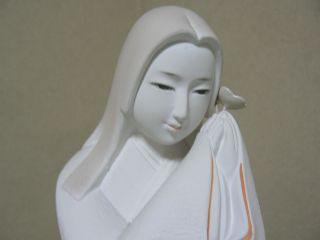 A Japanese Hakata Doll,  Prayer Of A Virgin. photo