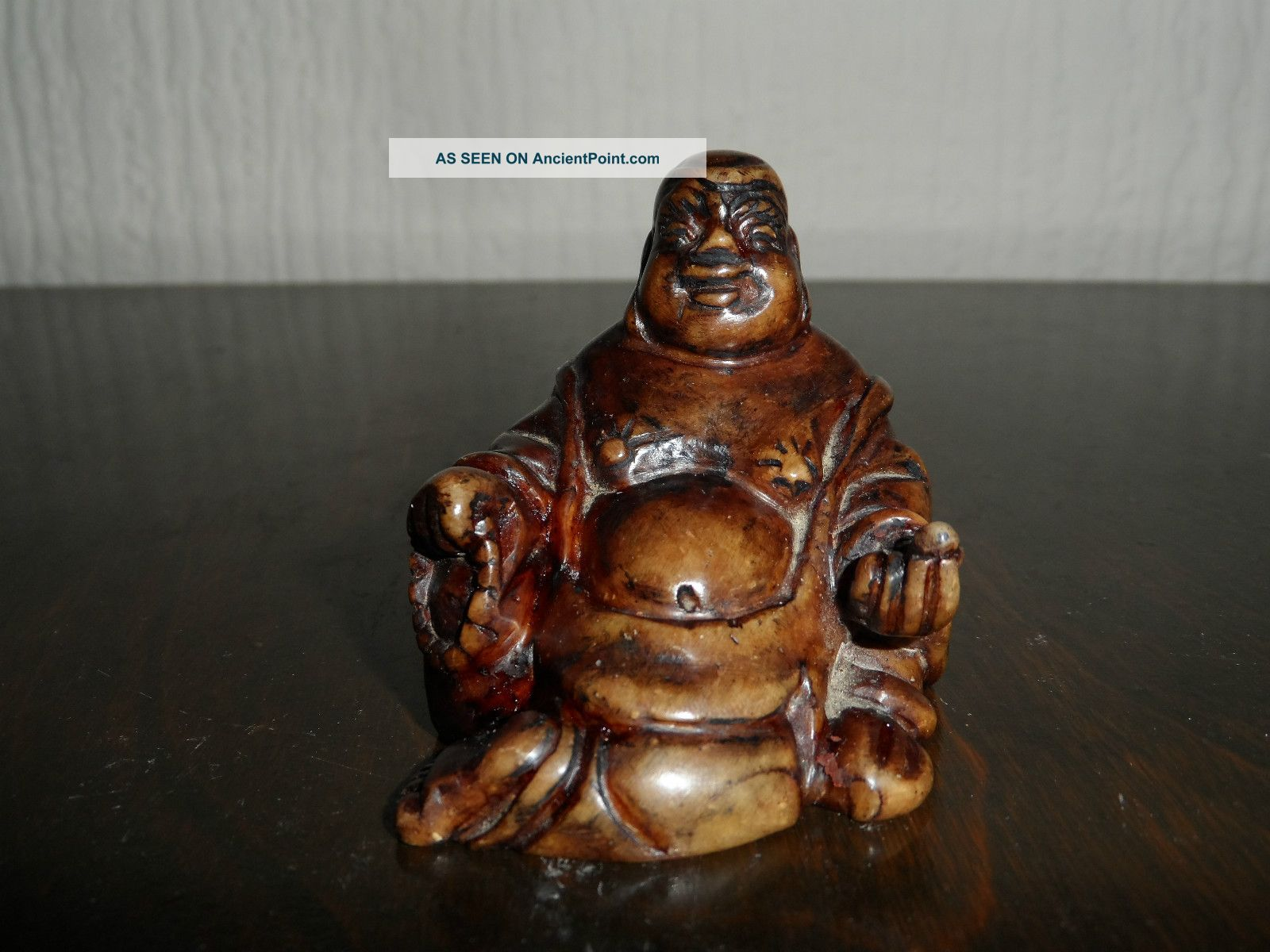 Small Carved Laughing Buddha Figure Buddha photo