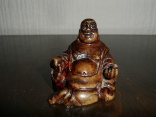 Small Carved Laughing Buddha Figure photo