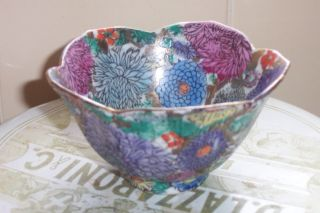 A Small Chinese Bowl With Flowers photo