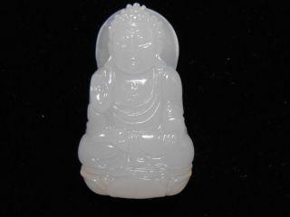 A White Jade Carving Sakyamuni Buddha.  Pendants photo