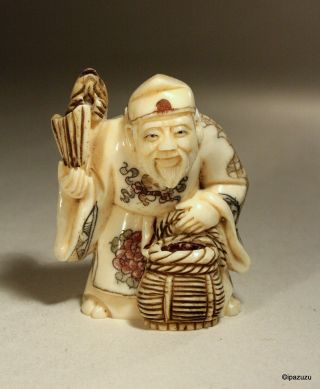 Japanese Carved Netsuke Man With Fish & Basket - Signed photo