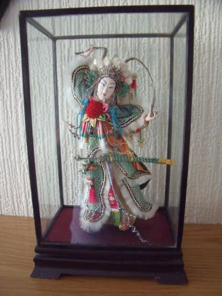 Chinese Cased Doll In Traditional Dress photo