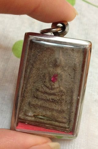 Phra Somdej Thai Amulet 2 With A Coin Behind On The Back Of The Amulet photo