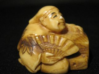 Antique Japanese Stained & Inked Ox Bone 象牙 Netsuke Immortal W.  A Fan,  Signed photo