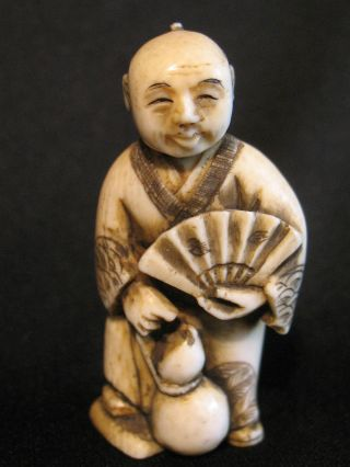 Antique Japanese 象牙 Ox Bone Netsuke Man W.  Fan,  Turning & Nodding Head,  Signed photo