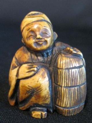 Antique Japanese Stained & Inked Ox Bone 象牙 Netsuke Man W.  A Basket photo