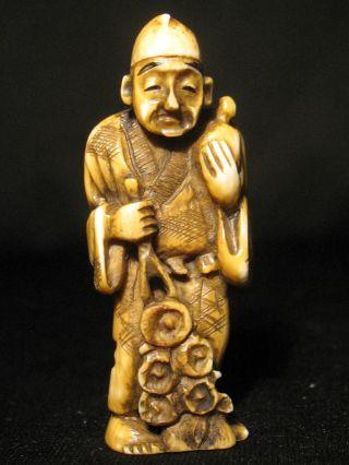 Antique Japanese 象牙 Stained Inked Ox Bone Netsuke Immortal? Man W Flowers Signed photo