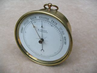 19th Century Brass Cased Aneroid Barometer By W.  Paviour. photo