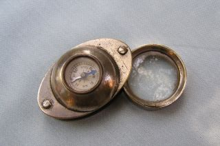 Antique Magnifier And Compass photo