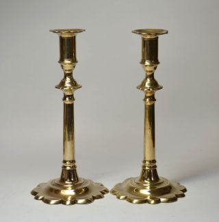 Pair Of 18th Century Petal Based Brass Candlesticks photo