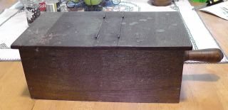 Old Early Wooden Voting Box With A Ball And A Black Square And A Black Checker photo