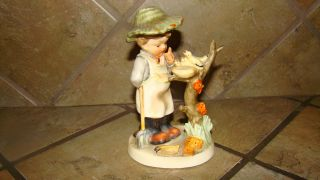 Figurine Thought To Be A Hummel But Not Sure photo