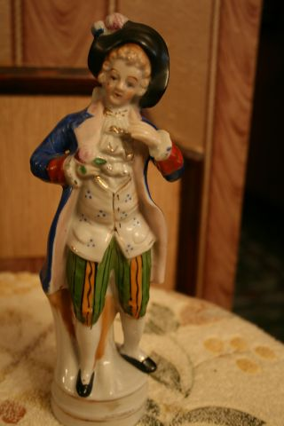Wonderful Antique Porcelain Figurin Man With Flower. photo