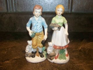 Homco Couple With Chopped Firewood Vintage photo