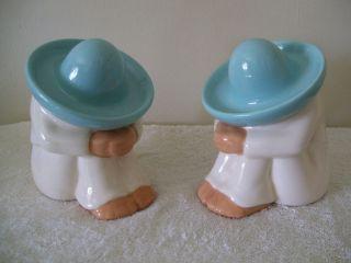 Pair Of Ceramic Men Figurines photo