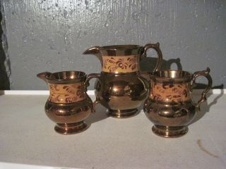 Trio (3) Antique Copper Lustre Pitcher Butterscotch photo