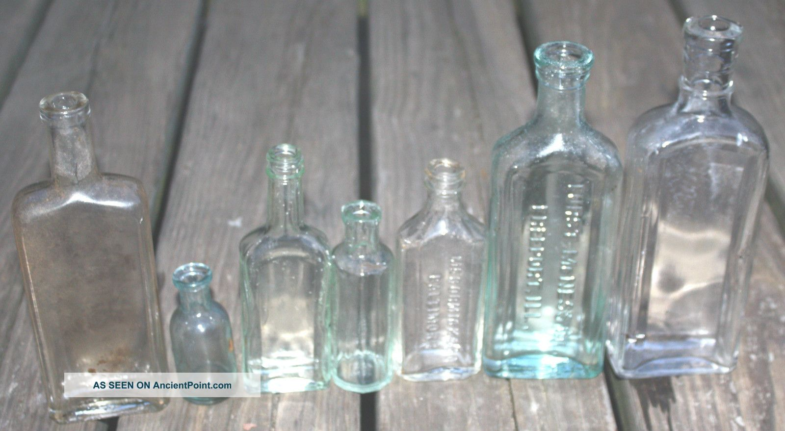 7 Antique Vintage Old Clear Green Blue Glass Cork Top Embossed Bottles Bottles photo