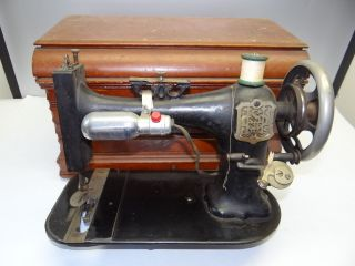 Antique Old Cast Iron Household Institute Broken Sewing Machine With Wooden Case photo