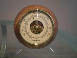 Fiddleback Mango Wood Turned Wall Barometer photo