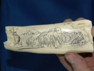 Scrimshaw Alaskan Bone Wooly Mammoths Fire Starter photo