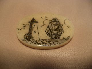 Scrimshaw Bone Worry Stone Ship / Lighthouse photo