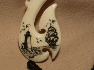Scrimshaw Ox Bone Maori Pendant Ship & Lighthouse photo