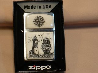 Scrimshaw Cow Bone Wide Zippo Lighter Ship - Lighthouse - Compass Rose photo