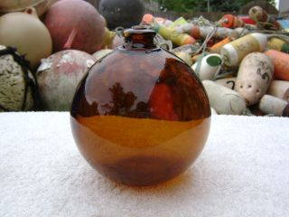 4+1/2 Inch Tall Northwest Glass Company Glass Float Amber Ball Nw2 Mark (262) photo