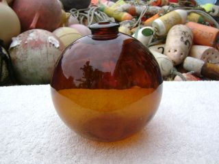 4+1/2 Inch Tall Northwest Glass Company Glass Float Amber Ball 1 Mark (264) photo