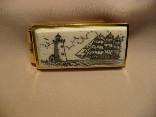 Scrimshaw Cow Bone Money Clip Side Ship/ Lighthouse photo