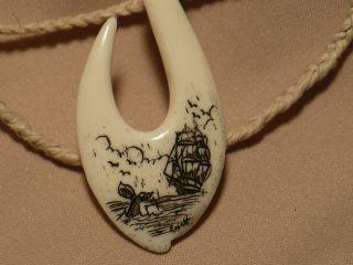 Scrimshaw Ox Bone Maori Pendant Ship & Whale Tail photo