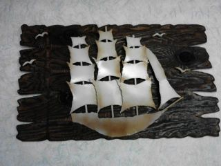 3d Metal Art Of Sail Boat And Sea Gulls Over Burnt Wood photo