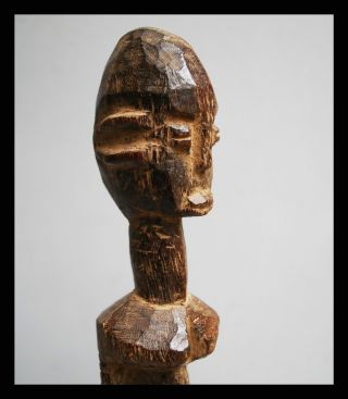 A Cubist Thil Figure From The Lobi Tribe Of Burkina Faso photo