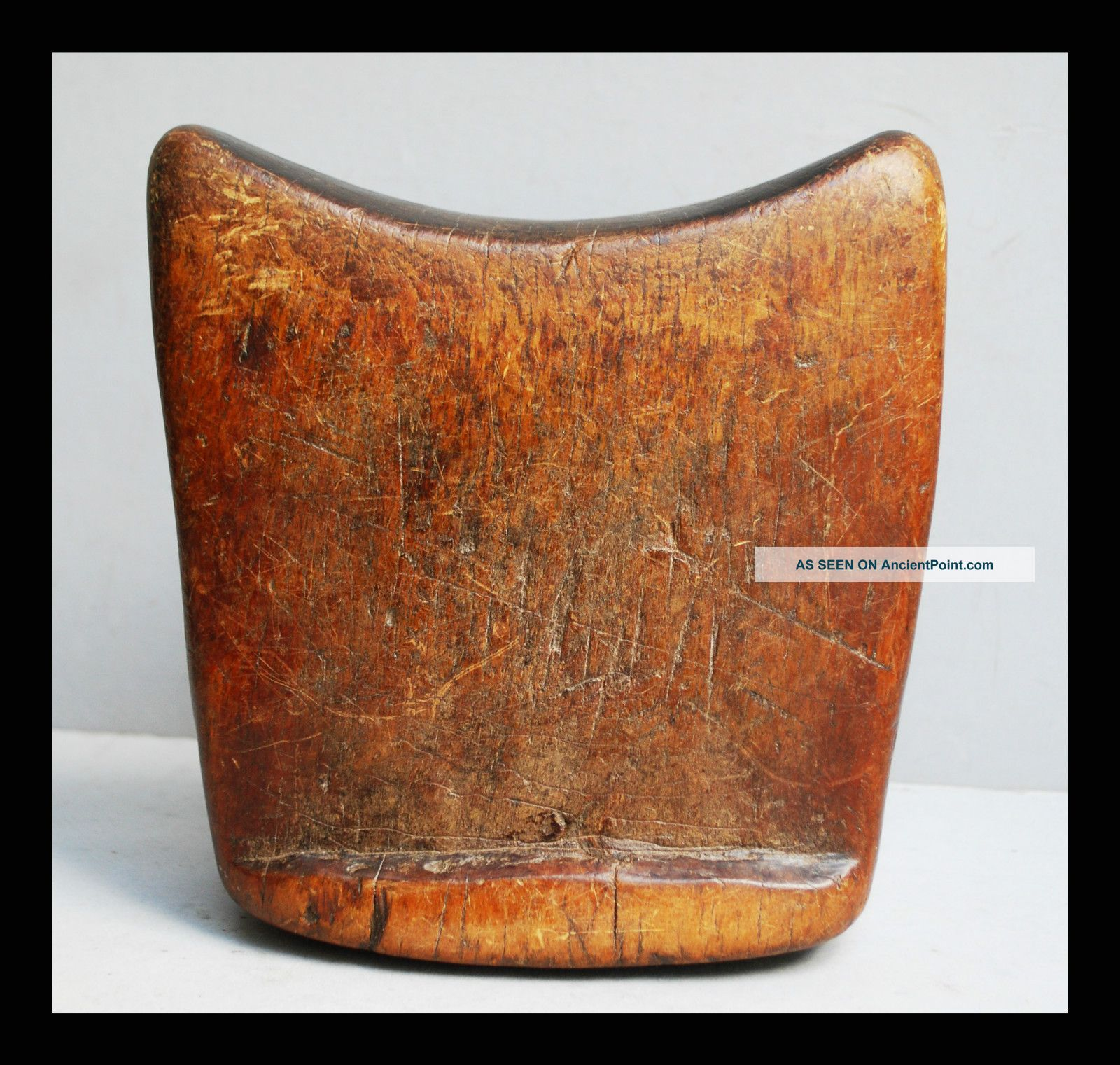 A Smoothly Shaped Headrest With Character Worn Patina Other photo