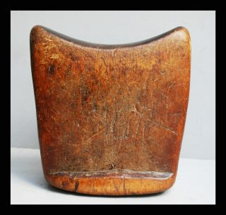 A Smoothly Shaped Headrest With Character Worn Patina photo