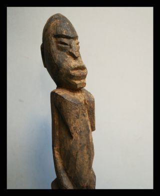 An Encrusted Thil Figure From The Lobi Tribe Of Burkina Faso photo