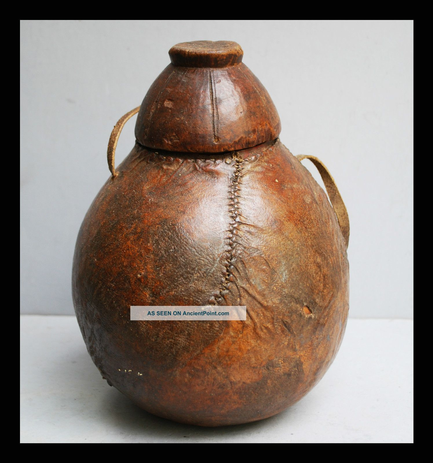 An Ethiopian Container With Lid,  Made Of Wood With Leather Stitched Cover Other photo