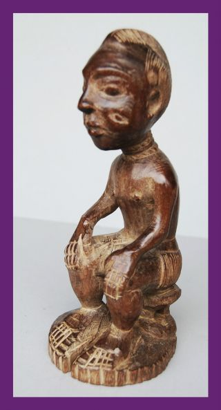 Enchanting Baule Seated Figure From The Ivory Coast photo