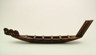 A Vintage Hand Carved Maori War Canoe Model. photo
