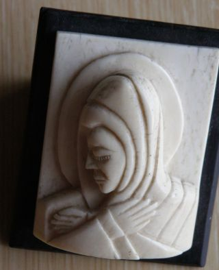African Faux Ivory Bone Carved Figure Of Saint ' S Head Mounted On Ebony photo