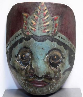 Old Wayang Mask Topeng Wajang Keris Tribe Art Indonesia photo