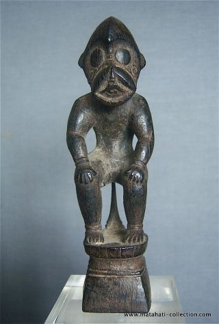 An Old Wooden Charm From The Ngaju Dayak,  Central Kalimantan,  Indonesia,  Borneo photo