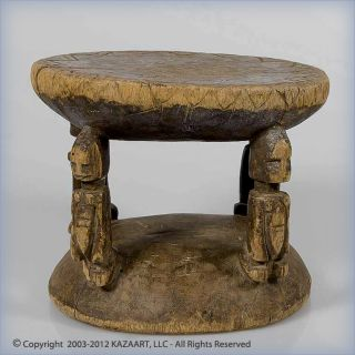 Old And Useddogon Wood Stool With Four Figures Mali photo