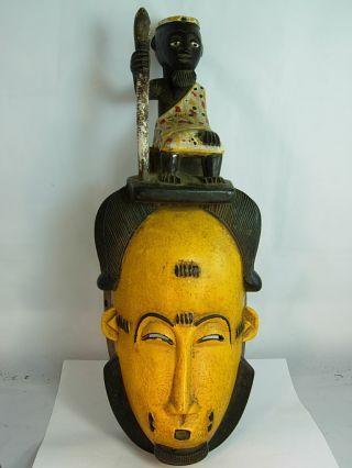 Yellow Baule Mask With Chief Figure,  Ivory Coast photo