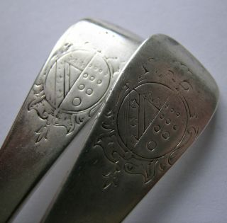 A George I Pair Of Armorial Silver Tablespoons,  Issac Davenport,  London,  1718 photo