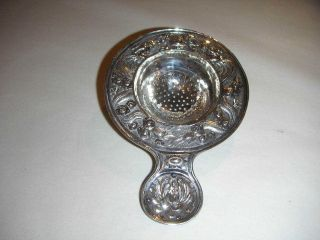 Chinese Silver Tea Strainer With Embossed Dragon Design To Rim photo