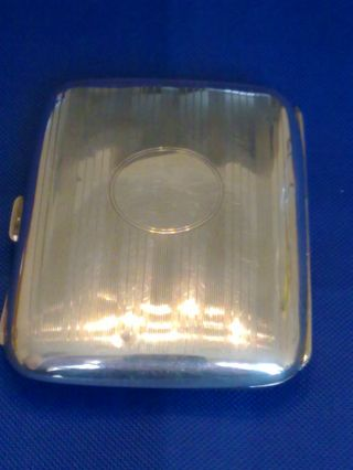 Solid Silver Ladies Cigarette Case With Purple Enamel Interior photo
