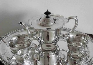 An Extremely Pretty Vintage Silver Plated Teaset With Scalloped Feature On Rim photo